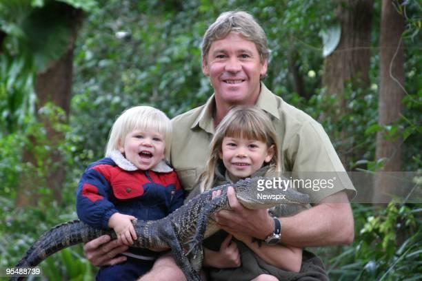 Bob Steve and Bindi Irwin pose with 3yr old alligator Russ at Australia Zoo on June 25 2005 on the Sunshine Coast in Australia