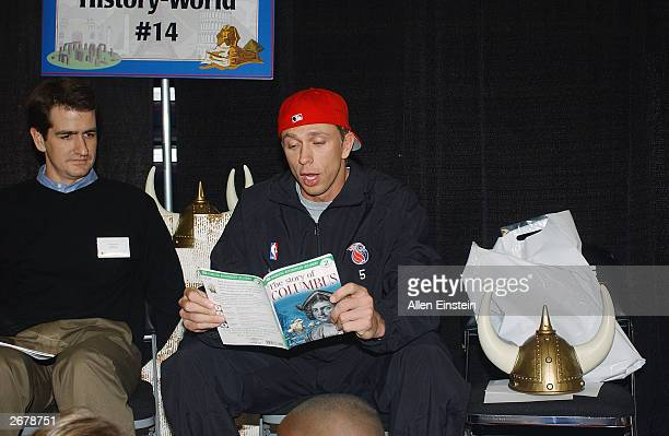 Bob Sura of the Detroit Pistons reads with school kids at the Read to Achieve event at the Palace of Auburn Hills on October 22 2003 in Auburn Hills...