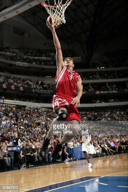 Bob Sura of the Houston Rockets shoots a layup against the Dallas Mavericks on January 12 2005 at the American Airlines Center in Dallas Texas NOTE...