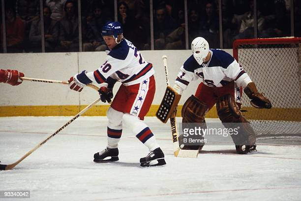 Bob Suter and goalie Steve Janaszak of Team USA in action against the Soviet Union National Team during an 1980 exhibition game on February 9 1980 at...