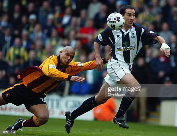 Bob Taylor of West Bromwich Albion takes the ball past Andy Myers of Bradford City during the Nationwide League Division One match played at Valley...