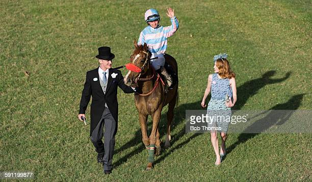 Winning Horse And Jockey With Owners