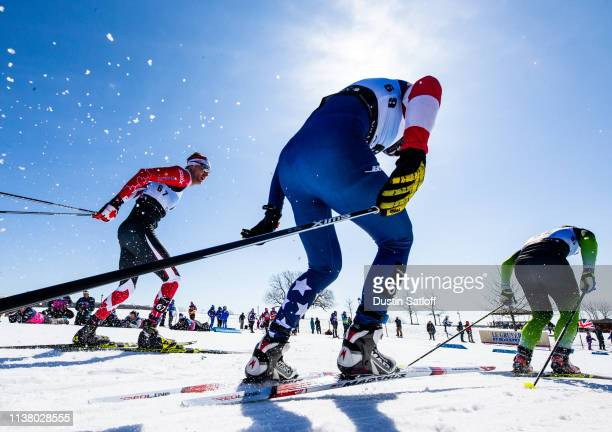 Bob Thompson of Canada and Ben Ogden of the United States competes in the Men's 15km freestyle pursuit during the FIS Cross Country Ski World Cup...