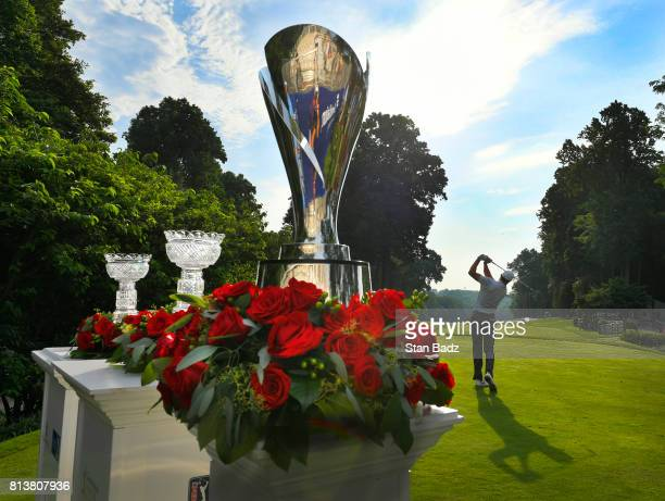 Bob Tway hits a tee shot with the Charles Schwab Cup and the Constellation SENIOR PLAYERS Championship trophies displayed on the first hole during...