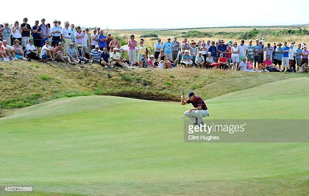 Bob Tway of the United States lines up a putt shot on the 8th hole during the third round of the Senior Open Championship at Royal Porthcawl Golf...