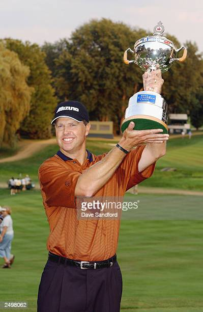 Bob Tway raises the trophy after winning the Bell Canadian Open on the 3rd playoff hole, at the Hamilton Golf and Country Club in Hamilton, Ontario,...