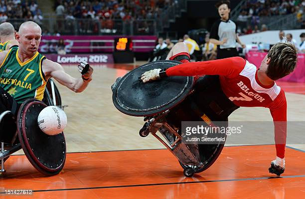 Bob Vanacker of Belgium falls after he clashes with Jason Lees of Austrlaia during the Mixed Wheelchair Rugby Open match between Australia and...