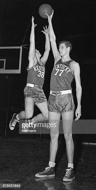 Bob Watson Kentucky guard leaps in vain attempt to take the ball away from Bill Spivy during a practice session at Madison Square Garden in...