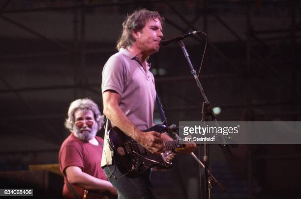 Bob Weir and Jerry Garcia of the Grateful Dead perform at the Hubert H Humphrey Metrodome in Minneapolis Minnesota on June 26 1986
