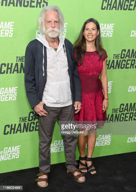 Bob Weir and Natascha Munter arrive at the LA Premiere Of The Game Changers at ArcLight Hollywood on September 4 2019 in Hollywood California