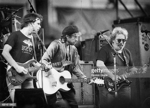 Bob Weir left and Jerry Garcia right of the Grateful Dead perform with Bob Dylan at a concert at Sullivan Stadium in Foxborough Mass on July 4 1987