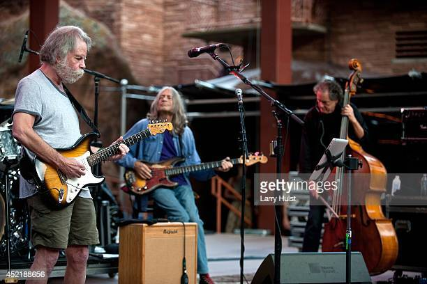 Bob Weir Robin Sylvester and Rob Wasserman performing with 'Ratdog' at Red Rocks Amplitheater in Morrison Colorado on July 11 2014