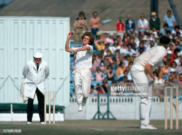 Bob Willis bowling for England during the 2nd Test match between England and Australia at Old Trafford Manchester 7th July 1977 The umpire is Tom...