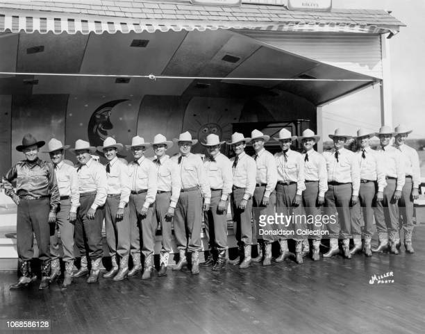 Bob Wills and His Texas Playboys pose for a portrait onstage circa 1940.