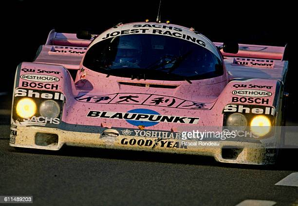 Bob Wollek of France drives the Joest Racing Porsche 962C during the FIA World Sportscar Championship 24 Hours of Le Mans race on 10 June 1989 at the...