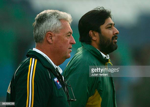 Bob Woolmer coach of The Pakistan team looks on with captain Imzamam ul Haq during a nets sesion held at The Gaddafi Stadium during the winter tour...