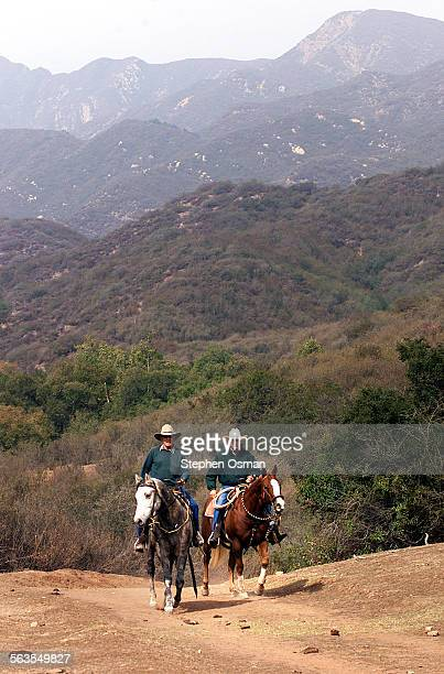 Bob Yanez 76, of Oakview, left, and Buzz Hunt 66, of Summerland, CA. Check on cattle in Wills Canyon on the Farmont Ranch in Ojai. The Ojai Valley...