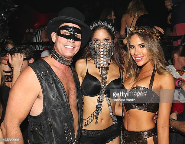 Bob Zangrillo Keir Alexa and guest attend the Trick or Treats 2015 Forbidden Ball event at Light night club on October 31 2015 in Las Vegas Nevada