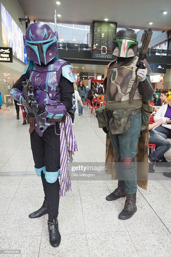 Boba Fett and a female bounty hunter from Star Wars on Day 2 of MCM London Comic Con at The London ExCel on May 28, 2016 in London, England.