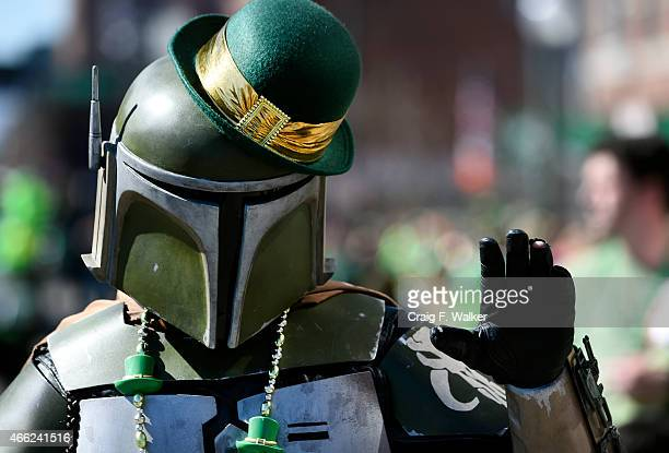 Boba Fett sports an Irish derby while marching with the Rocky Mountain Star Wars Fan groups during the Annual StPatricks day parade in Denver CO...