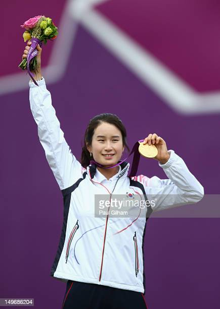 Bobae Ki of Korea celebrates with her Gold Medal on the podium following her Women's Individual Archery Gold Medal match against Aida Roman Arroyo of...