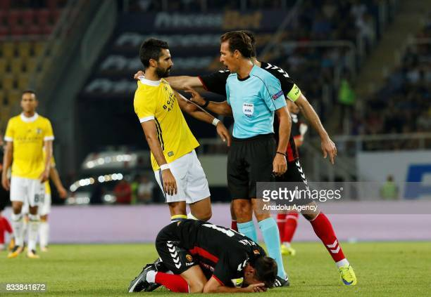 Boban Grncarov of Vardar argues with Alper Potuk of Fenerbahce during the UEFA Europa League play-off match between Vardar and Fenerbahce at Philip...