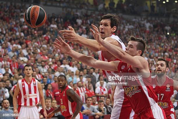 Boban Marjanovic, #13 of Crvena Zvezda Telekom Belgrade competes with Dimitrios Agravanis, #16 of Olympiacos Piraeus during the 2014-2015 Turkish...