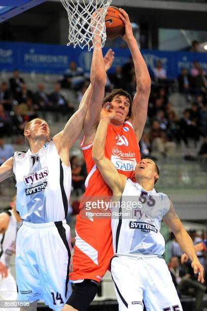 Boban Marjanovic, #20 of Hemofarm Stada competes with Donatas Zavackas, #14 and Evaldas Dainys, #55 of Lietuvos Rytas during Eurocup Basketball Semi...
