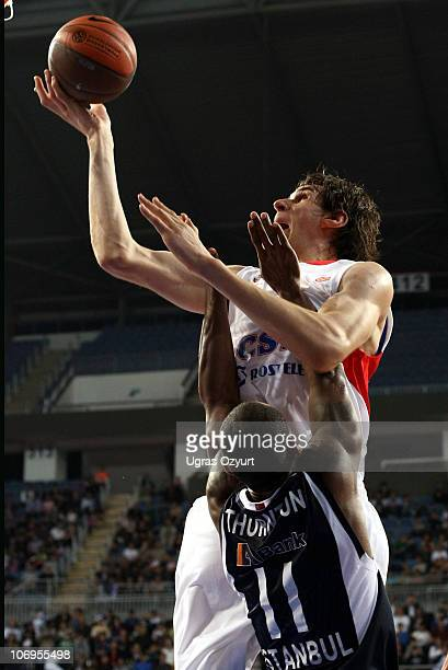 Boban Marjanovic, #22 of CSKA Moscow competes with and Bootsy Thornton, #11 of Efes Pilsen Istanbul competes with in action during the Turkish...