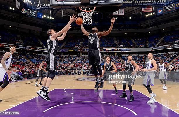Boban Marjanovic and Jonathon Simmons of the San Antonio Spurs rebound against the Sacramento Kings on February 24 2016 at Sleep Train Arena in...