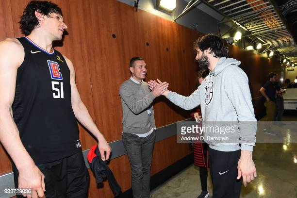 Boban Marjanovic and Milos Teodosic of the LA Clippers talks with Nemanja Vidic after the game against the Cleveland Cavaliers on March 9 2018 at...
