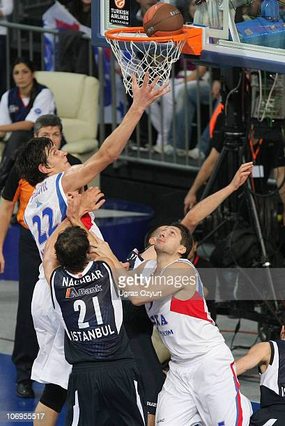 Boban Marjanovic and Nikita Kurbanov of CSKA Moscow compete with Bostjan Nachbar of Efes Pilsen Istanbul during the Turkish Airlines Euroleague Date...