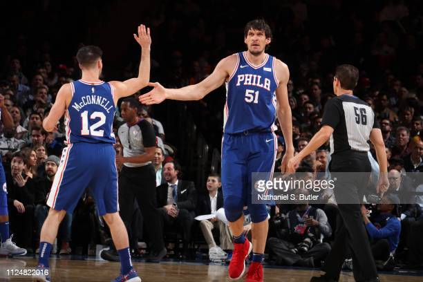 Boban Marjanovic and TJ McConnell of the Philadelphia 76ers highfive during a game against the New York Knicks on February 13 2019 at Madison Square...