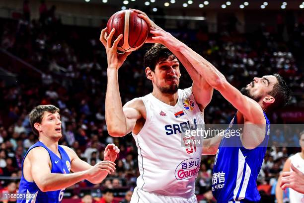 Boban Marjanovic of Serbia fight for the ball during the games 56 match between Serbia and the Czech Republic of 2019 FIBA World Cup at the Cadillac...