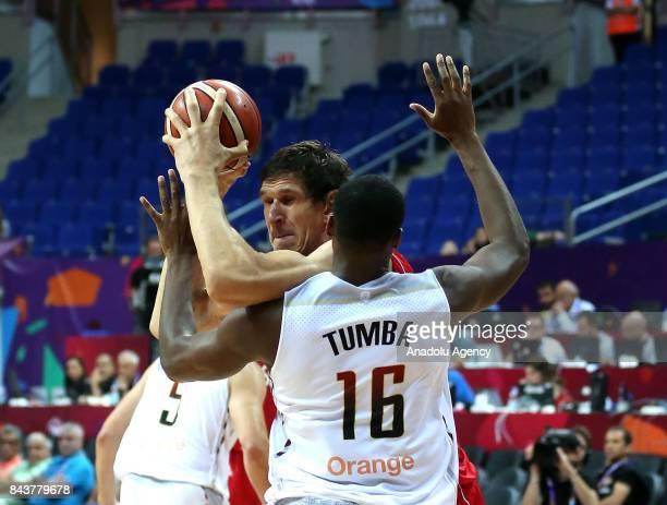 Boban Marjanovic of Serbia in action against Kevin Tumba of Belgium during the FIBA Eurobasket 2017 Group D Men's basketball match between Belgium...