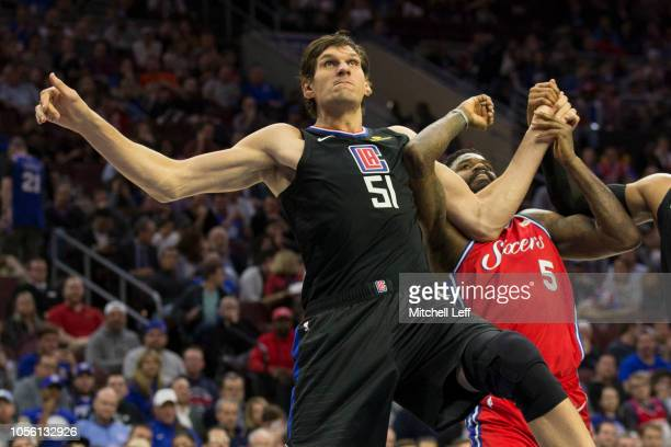 Boban Marjanovic of the LA Clippers boxes out Amir Johnson of the Philadelphia 76ers in the second quarter at the Wells Fargo Center on November 1...