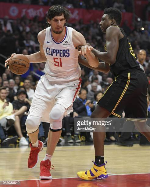 Boban Marjanovic of the LA Clippers drives against Thomas Bryant of the Los Angeles Lakers in the second half at Staples Center on April 11 2018 in...