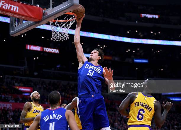 Boban Marjanovic of the LA Clippers dunks past Lance Stephenson of the Los Angeles Lakers during a 123120 Laker win at Staples Center on January 31...