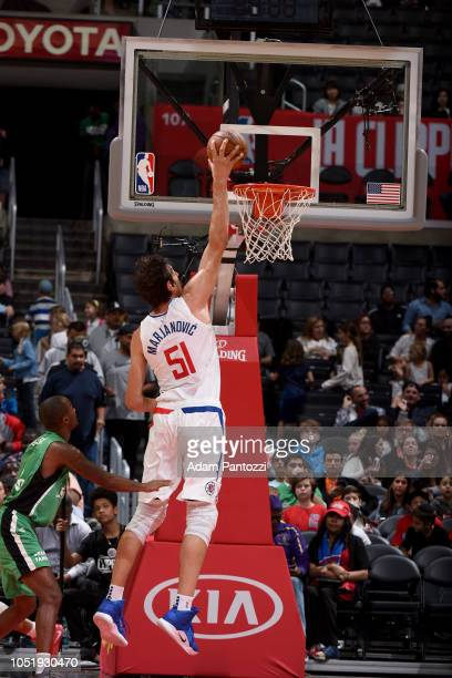 Boban Marjanovic of the LA Clippers dunks the ball against the Maccabi Haifa during a preseason game on October 11 2018 at Staples Center in Los...
