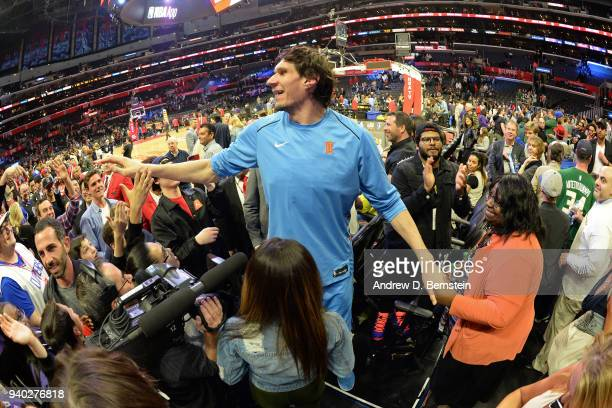 Boban Marjanovic of the LA Clippers exchanges high fives with fans after the game against the Milwaukee Bucks on March 27 2018 at STAPLES Center in...