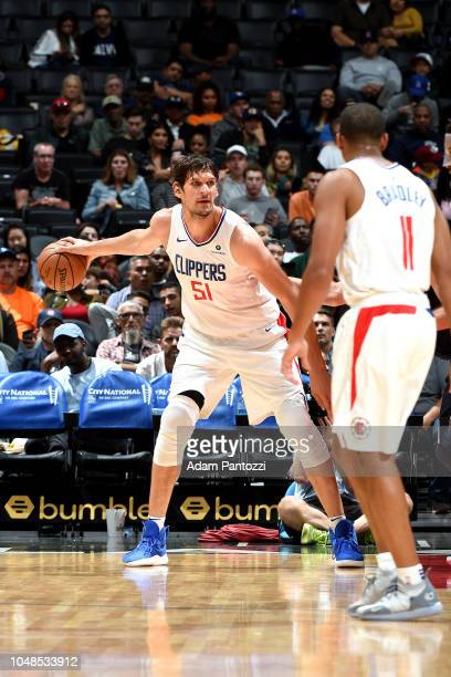 Boban Marjanovic of the LA Clippers handles the ball against the Denver Nuggets during a preseason game on October 9 2018 at Staples Center in Los...