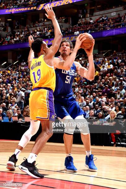 Boban Marjanovic of the LA Clippers handles the ball against the Los Angeles Lakers during a preseason game on October 6 2018 at Honda Center in...