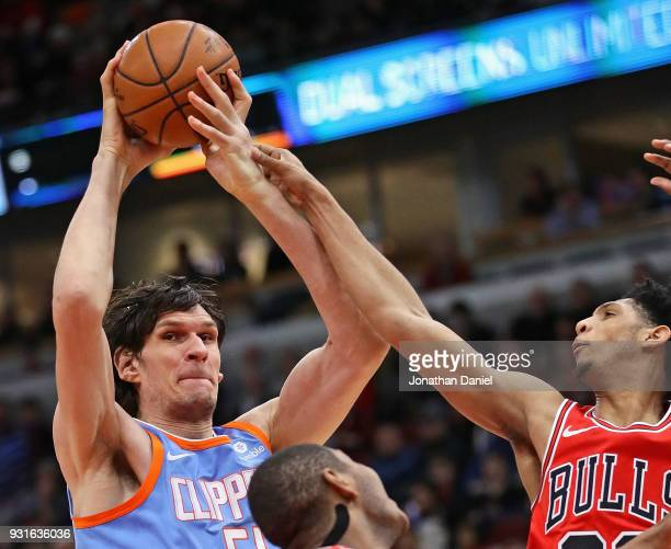 Boban Marjanovic of the LA Clippers is fouled by Cameron Payne of the Chicago Bulls at the United Center on March 13 2018 in Chicago Illinois NOTE TO...