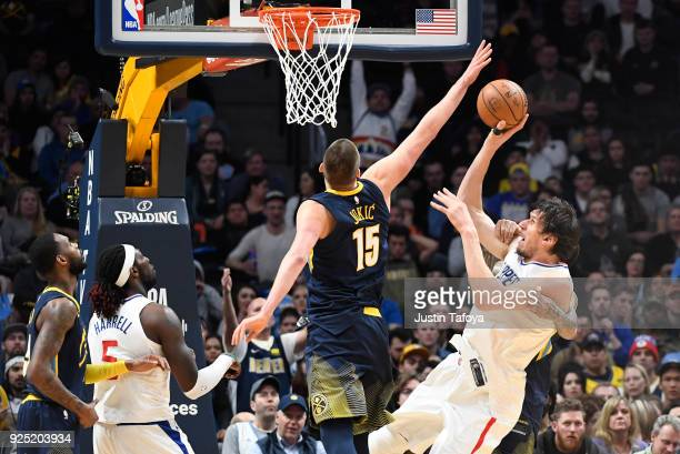 Boban Marjanovic of the LA Clippers is fouled during the game against the Denver Nuggets at Pepsi Center on February 27 2018 in Denver Colorado NOTE...