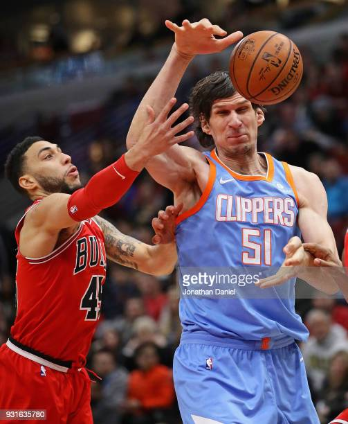 Boban Marjanovic of the LA Clippers looses control of the ball under pressure from Denzel Valentine of the Chicago Bulls at the United Center on...