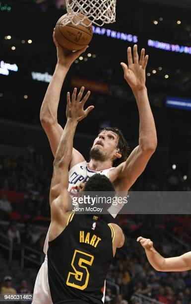 Boban Marjanovic of the LA Clippers shoots over Josh Hart of the Los Angeles Lakers in the second half at Staples Center on April 11 2018 in Los...