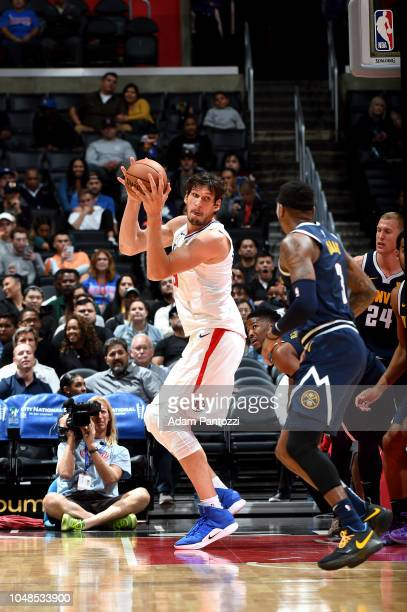 Boban Marjanovic of the LA Clippers shoots the ball against the Denver Nuggets during a preseason game on October 9 2018 at Staples Center in Los...