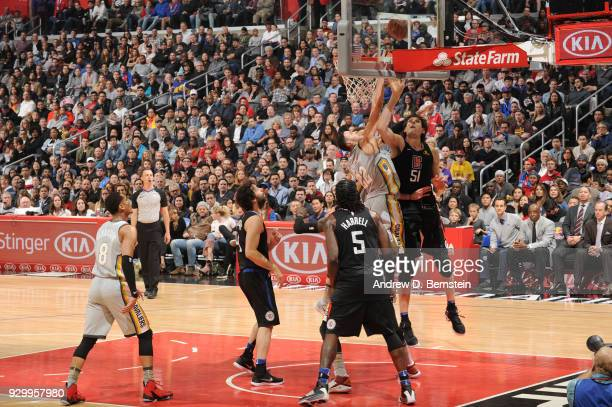 Boban Marjanovic of the LA Clippers shoots the ball against the Cleveland Cavaliers on March 9 2018 at STAPLES Center in Los Angeles California NOTE...