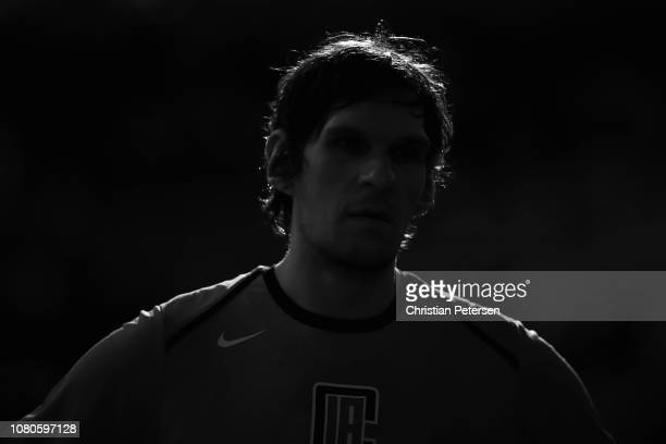 Boban Marjanovic of the LA Clippers stands on the sidelines during a timeout from the second half of the NBA game at Talking Stick Resort Arena on...