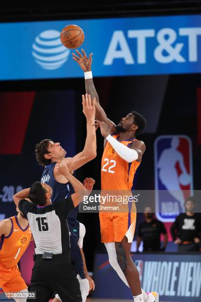 Boban Marjanovic of the Dallas Mavericks and Deandre Ayton of the Phoenix Suns jump for the ball during the game on August 13 2020 at AdventHealth...
